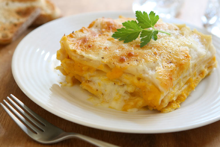 A lasagna like no other! Multiple cheeses, creamy sweet butternut squash enriched with mascarpone for the filling, doused in a simple white sauce sparked by a bit of Dijon and nutmeg