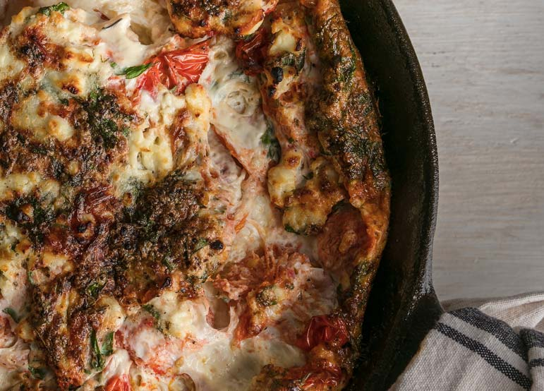 Diminish this glorious, gratifying breakfast-for-dinner main by calling it an omelette? Don't you dare!