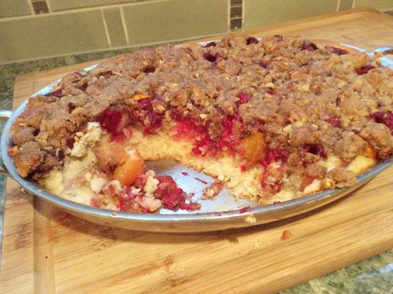 Classic dessert combines juicy nectarines with raspberries, a spiced cake and a toasted almond streusel-like topping