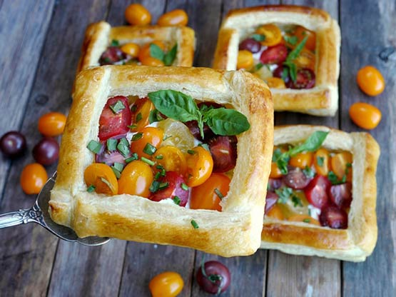 As a side or appetizer, these Puff Pastry Tomato Tarts -- filled with goat cheese and herbs -- are cute, elegant and fancy all at the same time