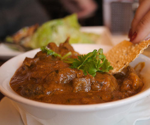 Aromatic rogan josh is a spicy slow-cooked lamb curry --- rich and creamy with plenty of depth