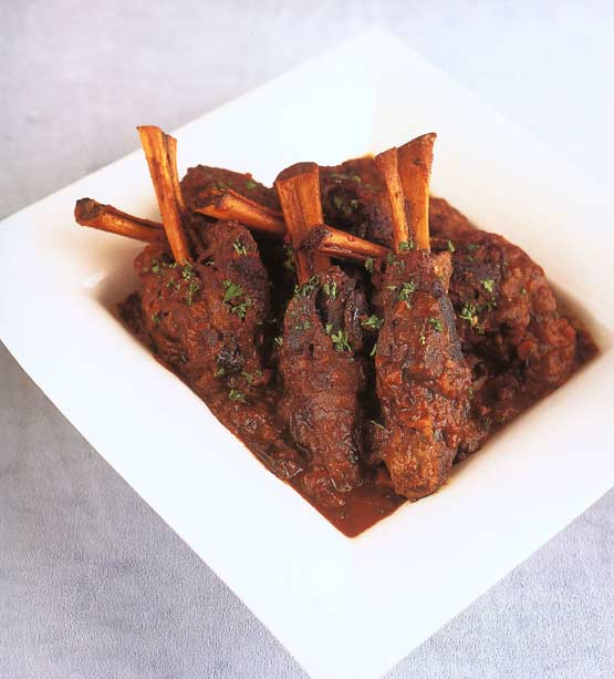 Magnificent main: Braised lamb shanks bathed in wine, dried fruit sauce add a slightly sweet touch for a tender, falling-off-the-bone result + Couscous with Leeks and Currants
