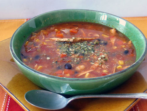 Chicken soup with black beans and pepitas  is a beautiful -- and beautifully seasoned --  potage bursting with flavor