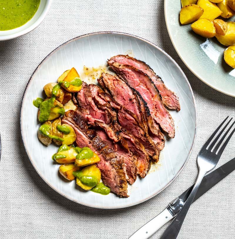 The 'grate outdoors' at home: Step up your steak night with cumin-rubbed flank and chimichurri potatoes