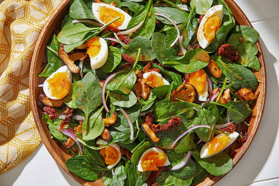 A hearty, healthful  salad bathed in a warm, bold dressing that has big umami flavor and meaty texture